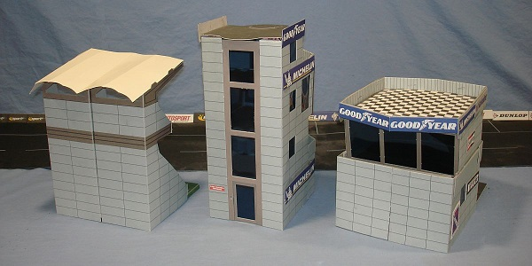 SCALEXTRIC_SLOT_CAR_RACING_CARDBOARD_KITS_C8152_GRANDSTAND_C8151_CONTROL_TOWER_C8150_PIT_BUILDING_BACKS (1).JPG